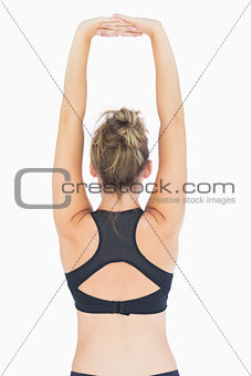 Woman stretching arms reverse