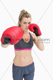 Woman standing in boxing gear