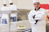Chef standing beside salad