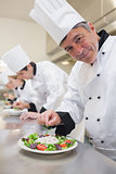 Cheerful Chef's preparing their salads