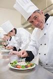 Cheerful Chef's preparing their salads