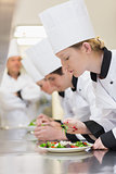 Chef's applying finishing touches to salads