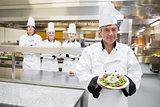 Head chef presenting salad