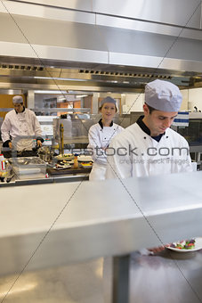 Three Chef's cooking