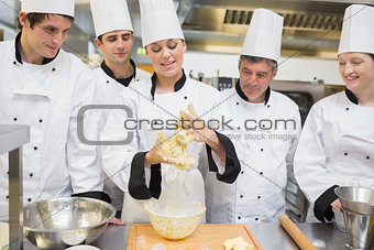 Class watching pastry teacher forming the dough