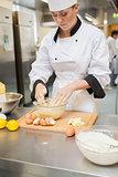 Baker mixing dough