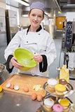 Pastry chef whisking egg whites