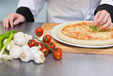 Pizza being garnished