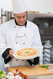 Chef admiring his pizza