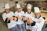 Team of Chef's giving thumbs up