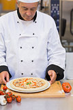 Chef preparing a mushroom pizza