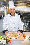 Chef with a pizza