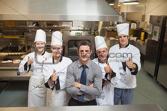 Five workers in restaurant