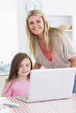 Mother and child smiling with a laptop