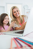 Woman and girl at the laptop and pointing