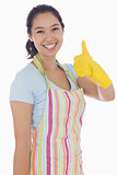 Woman in cleaning clothes giving thumbs up