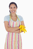 Woman holding gloves and wearing an apron