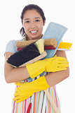 Woman nearly dropping her cleaning tools