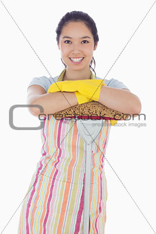 Smiling woman leaning on mop