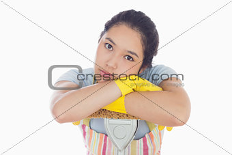 Sad woman leaning on mop