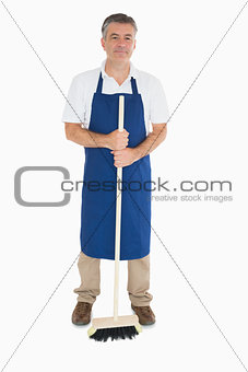 Man in apron with brush