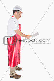 Butcher using meat cleaver