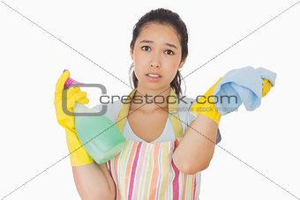 Weary woman with spray bottle and rag