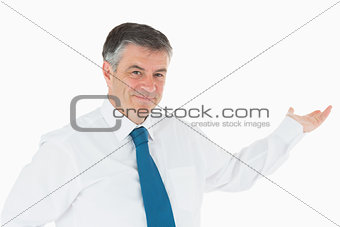 Smiling businessman holding out his hand