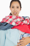 Woman overwhelmed with amount of dirty laundry