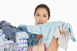 Frowning woman taking out dirty laundry