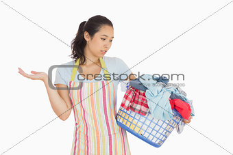 Quizzical looking young woman looking at basket