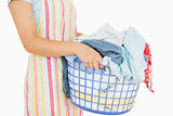 Woman holding a basket full of laundry