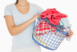 Brunette holding a basket full of laundry