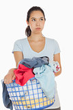 Exasperated woman holding a basket full of laundry