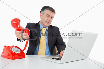 Man passing the phone to the camera