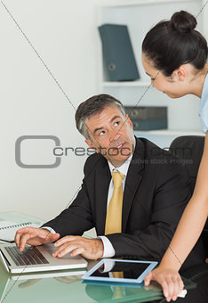 Business man and woman working in team