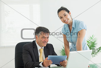 Business man and woman smiling together