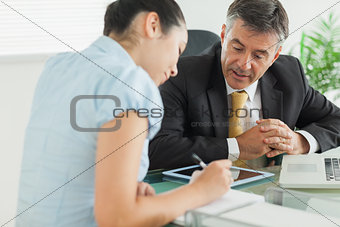 Business man and woman working at table