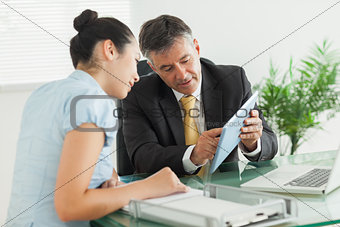 Business man explaining something with digital tablet