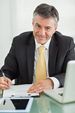 Business man smiling while working