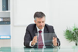 Business man holding a virtual screen