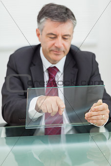 Business man scrolling on a virtual screen
