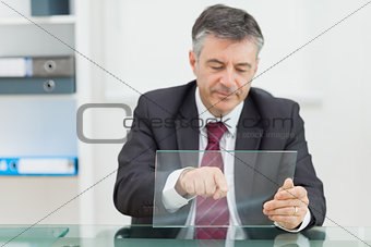 Business man writing something on a virtual screen