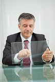 Man writing on a virtual screen