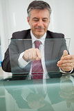Smiling man touching on a virtual screen