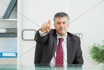 Business man pointing seriously