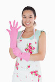 Woman putting on plastic gloves