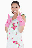 Woman wearing rubber gloves giving thumbs up