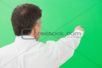 Well-dressed businessman pointing to copy space
