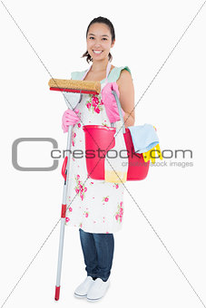Woman holding some cleaning tools